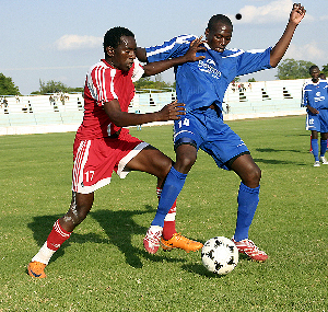 Red Arrows' Danny Siyuni plots his move against Nkwazi's Brian Musonda during the FAZ-KCM week 23 match played at Nkoloma stadium