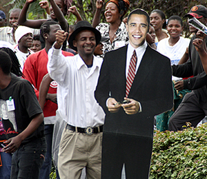 A man in Lusaka shows off his Barack Obama placard