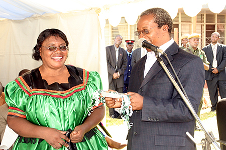 Auditor General Anna Chifungula receives keys from ministry of finance permanent secretary Wamundila Mbikusita-Lewanika for the auditor's office in Kasama during the official opening