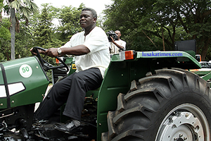 AGRICULTURE minister Brian Chituwo driving one of the tractors donated by the Libyan government