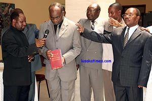 EVANGELICAL Fellowship of Zambia executive director Paul Mususu is joined by other clergy in dedicating the Mbunda Bible which was launched in Lusaka