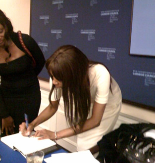 Dambisa signing a fan's book