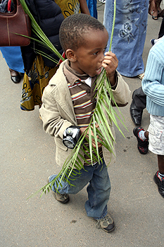 A child participating during palm sunday