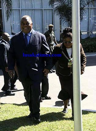 President Rupiah Banda holds Auditor General, Anna Chifungula's hand when going for a photo session after the AFROSAI seminar in Lusaka.