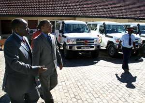 Health Minister Kapembwa Simbao and National AIDS Council director general Ben Chirwa (l) inspect vehicles that were handed over to the council in Lusaka