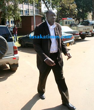 Former ministry of health permanent secretary Simon Miti leaving the Zambia Police Service headquarters.