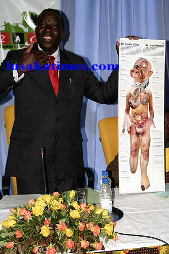 FILE: Health deputy minister Mwendoi Akakandelwa displays a placard on the effects of smoking during the launch of the smoke free Lusaka campaign