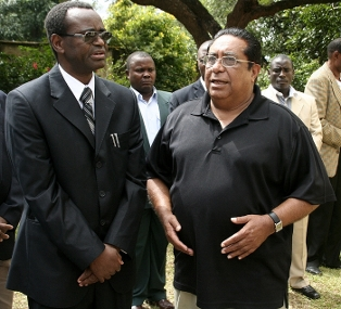 Vice president George Kunda talks to Ibrahim Malik, brother-in-law to the late Lands deputy minister Nasim-Ul-Gani Hamir when he visited the late Hamir's funeral house in Lusaka