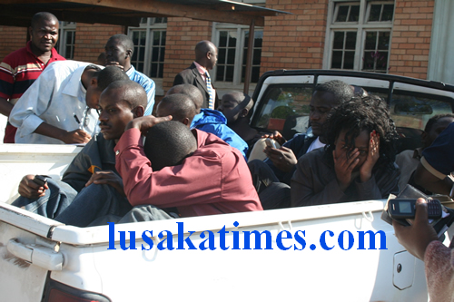 Some students from the Copperbelt University bundled in a police van before being feried to the magistrate Court in Kitwe