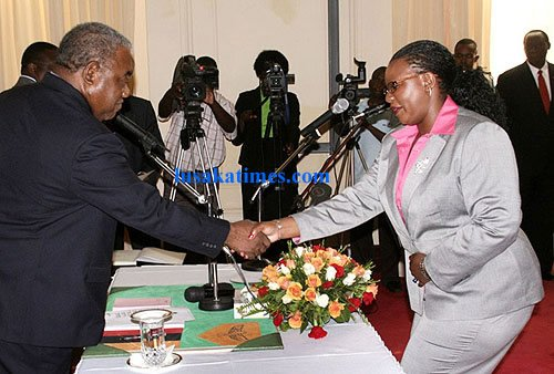 President Rupiah Banda receives an affidavit from newly appointed Education Minister Dora Siliya at a swearing in ceremony at State House