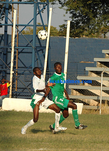 Green Buffaloes Sekelani Mwanza races for the ball against Choma Eagles' Moses Sakala during the FAZ-KCM week 15 match played at Woodlands Stadium.