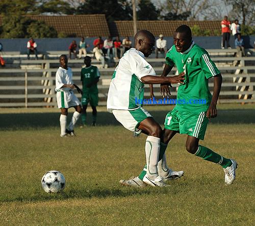 Choma Eagles' Tindi Mwanza (l) and Green Buffaloes Ken Ngambi (r) fight for the ball during the FAZ-KCM premier league week 15 match played at Woodlands stadium. Buffaloes won 2-0