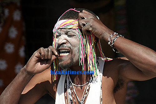 Mysterious .. a dancer putting fire in his mouth during a traditional dance at the Lusaka international airport