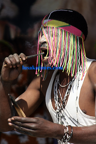 A traditional dancer 'eating' fire during a performance at the Lusaka international airport