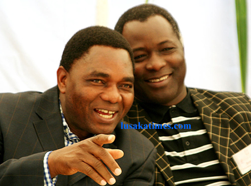 United Party for National Development leader Hakainde Hichilema chating with party vice president Richard Kapita during the opposition party General Assembly in Lusaka.