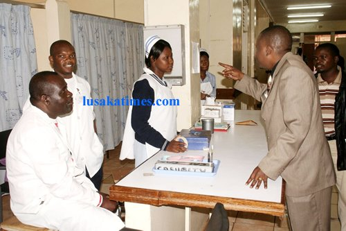 New Generation Party president Humphrey Siulapwa arguing with nurses who are on strike at the University Teaching Hospital in Lusaka.