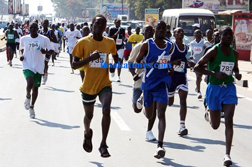 Some participants sprinting during the inter-company relay in Lusaka