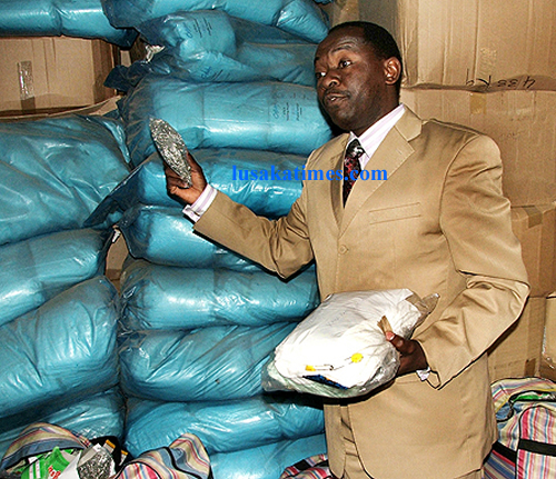 Henry Kapoko's lawyer Kelvin Bwalya showing baby kits stocked at Kapoko's home in Lusaka