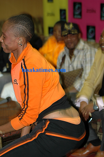 One of Kofi Olomide's dancers giving a snippet of her dancing skills at Lusaka international airport on arrival