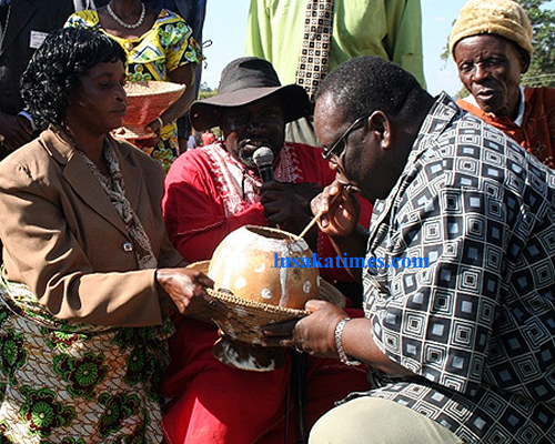 Northern Province Minister Charles innaugurates a traditional brew chipumu after he officially opened Mutomolo traditional ceremony for the Mambwe in Mbala