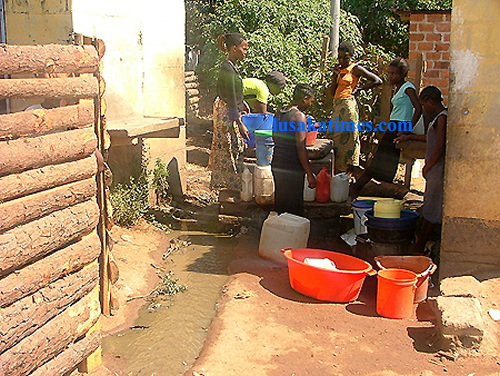There was a shortage of water in Ndola at the weekend. Here, women in Masala township queue up for their turn to draw water from a communal tap.