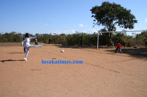 Lusaka province Sports co-ordinator,Doris Mulenga,kicking off the ball at Chinkuli sports field in Chongwe