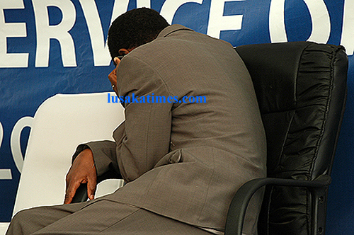 Vice president George Kunda answering a call on his mobile phone during the public service day commemoration in Lusaka