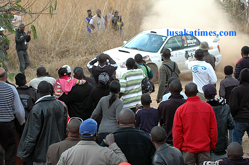 Motor rally fans are mesmerised by speeding cars that left them in a cloud of dust during the 2009 Zambia motor rally in Chisamba