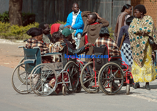 Disabled people camped outside the ministry of community development and social services