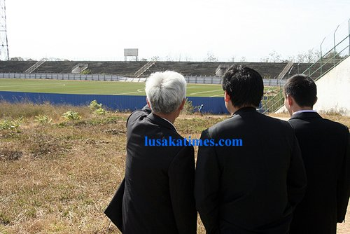 Officials from Chinese An Hui construction firm inspect the dilapidated Independence stadium in Lusaka where they have been engaged to refurbish the infrastructure