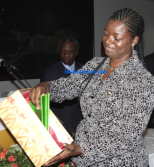 Tourism minister Catherine Namugala scruitinise the national environment policy during the launch in Lusaka