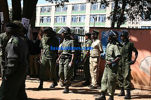 Police in riot gear keep vigil at the Ndola central hospital