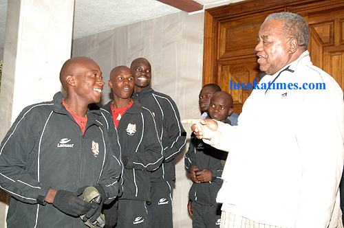 President Rupiah Banda chatting with Under-14 soccer players from Chiparamba academy before they left for Sweden