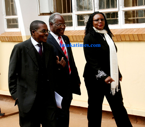 Dora Siliya (far l) with officials from Ecobank at Kabulonga boys secondary school in Lusaka