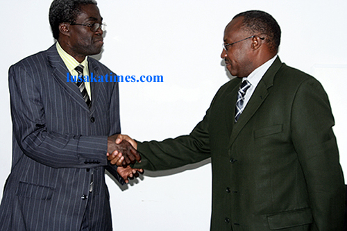 Local government minister Benny Tetamashimba welcomes his counterpart from Rwanda Protais Musoni to his office in Lusaka