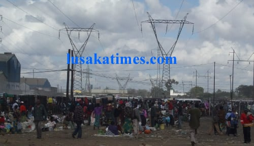 Business as usual  under Zesco high voltage lines behind Soweto market