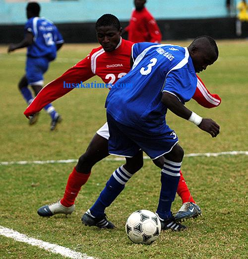 Konkola Blades' Maybin Chishimba plots his move against Red Arrows' Chiwanki Lyainga during the FAZ-KCM league rescheduled week three match played at Nkoloma Stadium in Lusaka