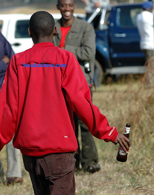 An unidentified youth on a 'drinking spree' during the 2009 Zambia motor rally in Chisamba