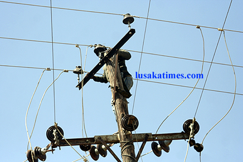 File: A ZESCO LTD worker working on high voltage power cables
