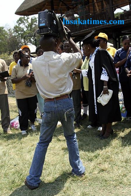 A cameraman in Lusaka struggling to shoot pictures of First Lady Thandiwe Banda in Lusaka