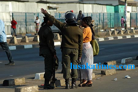 Police officers confront a street vendor during an operation to remove the hawkers from the street