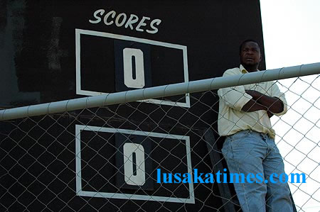 A scoreboard attendant waiting for Zanaco and Forest Rangers players' to score for him to show the tallies on his board