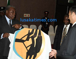 President Banda about to unveil the First National Bank plaque during the launch in Lusaka