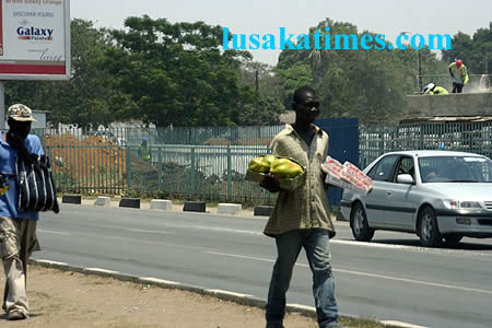 Street hawkers peddling their wares along the great east road at Mandhill