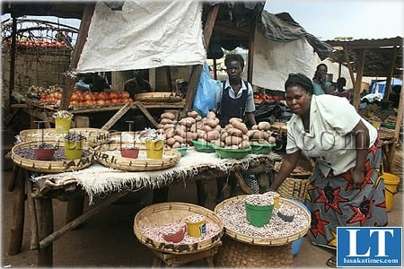 File:An unidentified woman and her daughter selling vegetables and other foodstuffs at Kapapa market in Chipata, Zambia