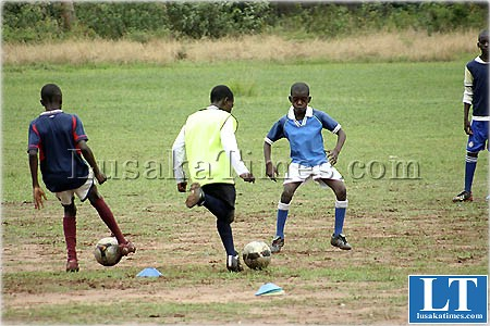 Yong boys playing social football at Lusaka club