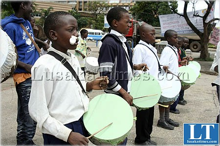 Youthful members of Ushers Band and majorettes playing home made