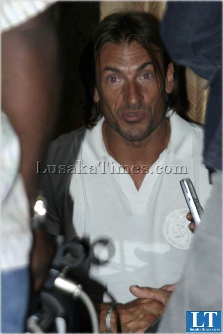 Zambia national soccer team coach Herve Renard talks to reporters after returning from Rwanda