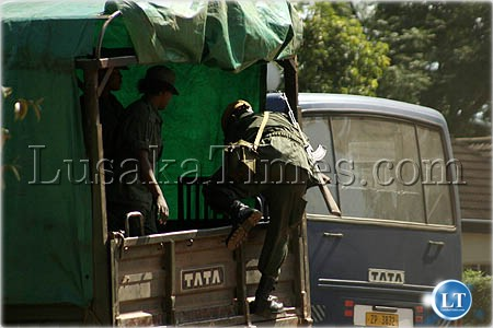 File:Police transportation...Female police officers disembark from a lorry after a one hour thirty minutes drive from Lusaka to Mazabuka