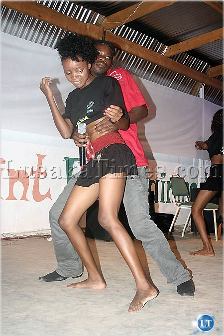 FILE: Dandy Crazy dances with one his dancing queens in Chipata